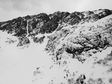 Black And White Shot Of Snow-Covered Austrian Alpine Peaks