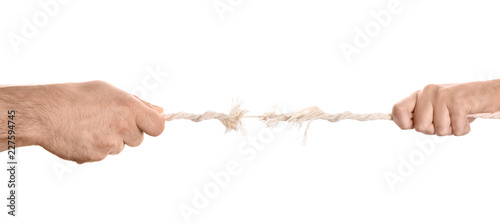 Man and woman pulling frayed rope at breaking point on white background Canvas Print