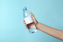 Woman Holding Plastic Bottle O...