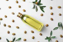 Flat Lay Composition With Bottle Of Olive Oil On Light Background
