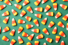 Flat Lay Composition With Delicious Candy Corns On Color Background