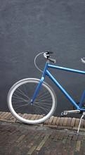 Hip Blue Bike On The Street