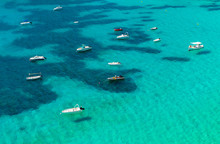 Boats In A Clear Blue Sea