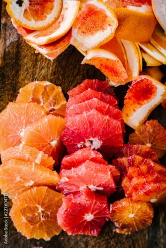 An assortment of sliced citrus fruits