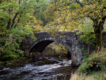 Old Stone Bridge Over The River