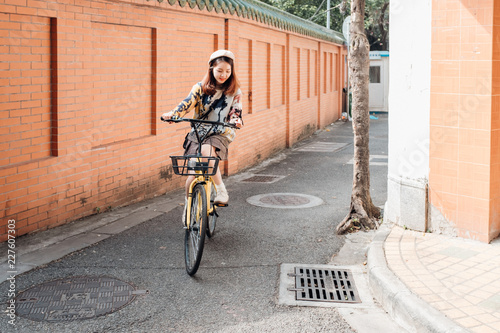 Asian young teenager girl on a bike