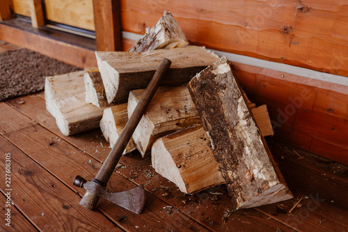Rustic Pile of Wood with Axe