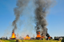 Burning Village. The Fire In The Wooden House Spread To The Neighboring Houses