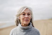 Senior Woman On The Beach In Winter.