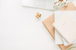 Leinwanddruck Bild - Laptop, notebook, cotton branch on white background. Flat lay, top view minimal home office desk workspace.