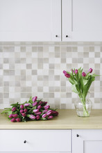 Lilac Tulips In A Clean Contem...