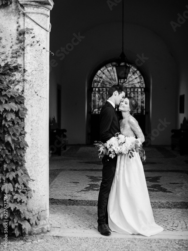 Elegant couple standing at old building