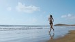 Running woman, female runner jogging during outdoor workout on beach., fitness model outdoors.