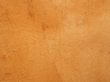 A Rough Burned Orange Ochre Colored Textured Stained Wall Background