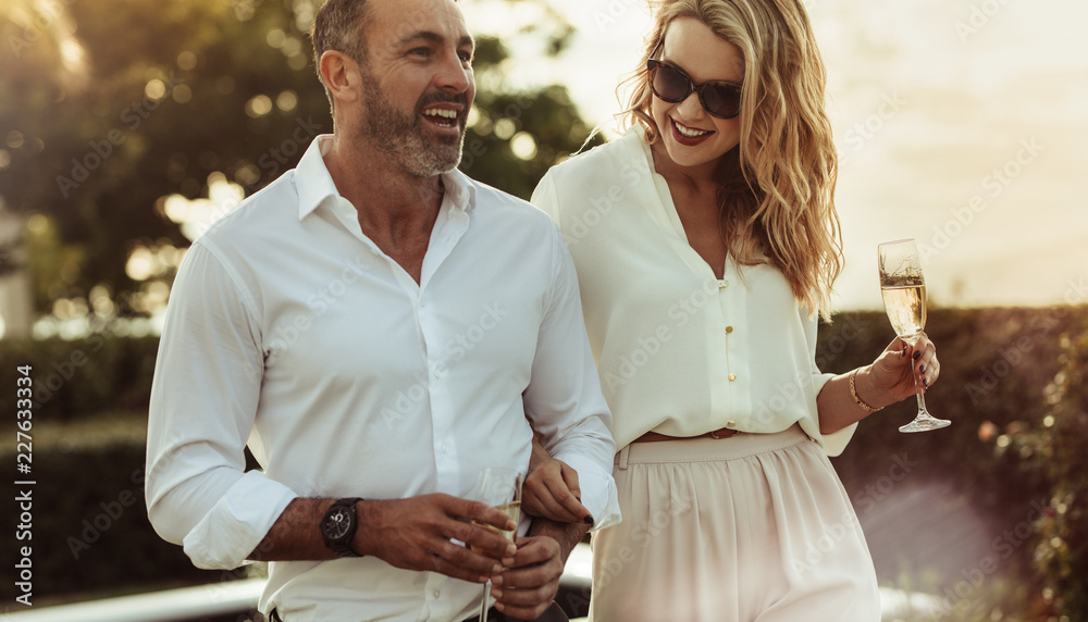 Fototapety, obrazy: Beautiful couple with a glass of wine outdoors