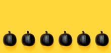 Black Colored Pumpkins On A Br...