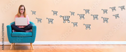 Cuadros en Lienzo Online shopping with young woman using her laptop in a chair