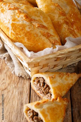 Lithuanian kibinai meat pies close-up. vertical