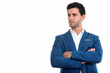 Studio shot of young handsome Hispanic businessman thinking with