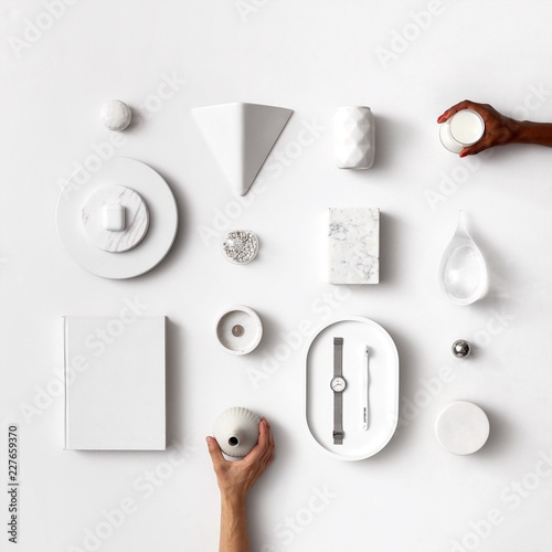 White design items flatlay and hands with different skin colors coming in