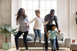 canvas print picture - Full length black African whole family have a fun. Married couple with little kids toddler son preschool daughter dancing moving in living room at new home. Happy family spend time together concept