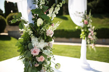 Outdoor Wedding Ceremony. Wedding Chuppa Decorated With Fresh Flowers