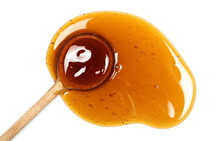 Honey And Wooden Spoon Isolate...