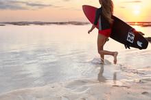 Back View Of Running Girl Surf...