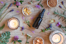 Bottles Of Essential Oil With Frankincense, Hyssop, Wormwood And Other Herbs