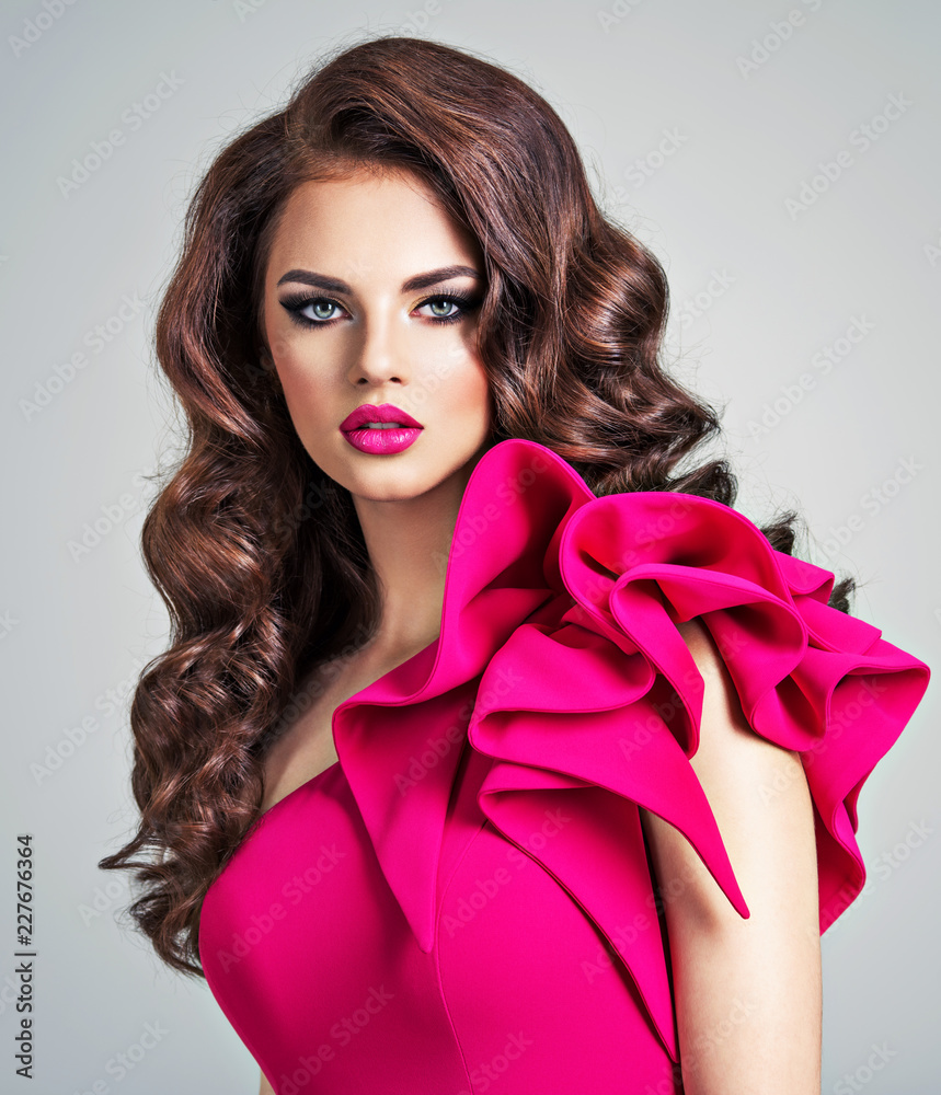 Fototapeta Woman wearing fashionable and creative red dress with a creative hairstyle.