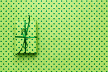 Green Gift Box On Wrapping Pap...