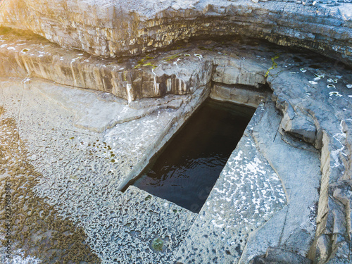 Aerial view of the famous Wormhole (Poll na bPeist in gaelic) in Inishmore, Ar Canvas Print