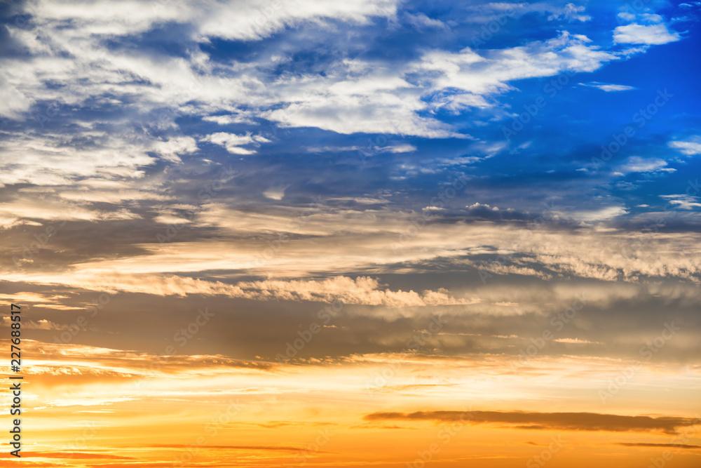 Fototapeta Orange and blue sky with dramatic sunset