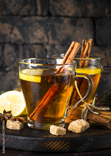 Staande foto Thee Autumn hot tea with lemon and spices