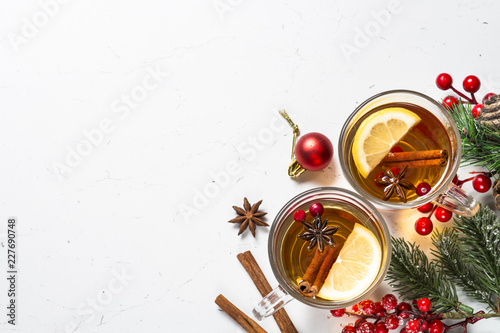 Foto op Aluminium Thee Winter hot tea with fruit, berries and spices on white table.
