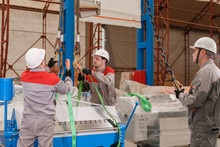 Manufacture Workshop. Move The Crane With Beam. Workers Adjusts The Machine In The Warehouse. The Production Of Ventilation And Gutters. Tool And Bending Equipment For Sheet Metal.
