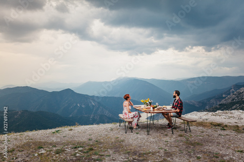 Fotografie, Obraz Romantic dinner of young couple on mountain top