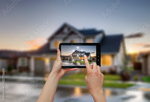 Remote home control/  Smart home control on tablet.