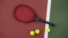 Tennis Racket With Balls On Green And Red Background