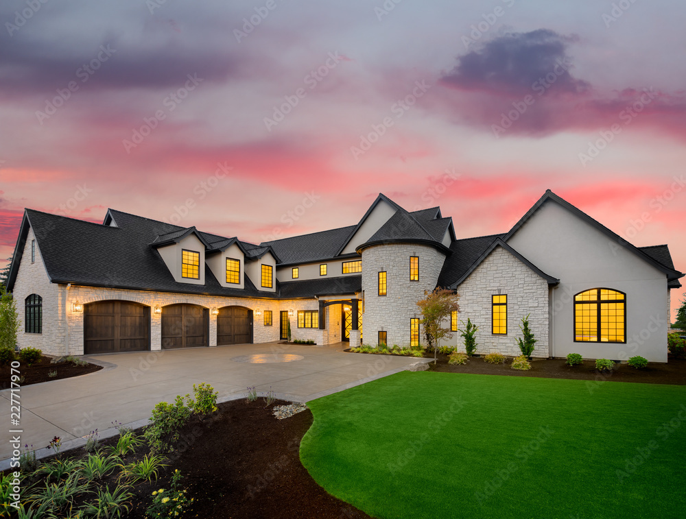 Fototapety, obrazy: Stunning Luxury Home Exterior at Sunset with Colorful Sky. This Mansion has Three Garages, Turret Style Tower, and Two Floors