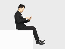 Side View Of Business Man Sitting On Blank Panel