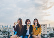 Happy group of asian girl friends enjoy laughing and cheerful sparkling wine glass at rooftop party,Holiday celebration festive,teeage lifestyle,freedom and fun.