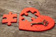 Red Heart Puzzle Without Part And An Old Vintage Key On Wooden Background. Open Heart For Love, Valentine's Day