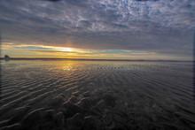 Sunset Over A Beach Near Cape ...