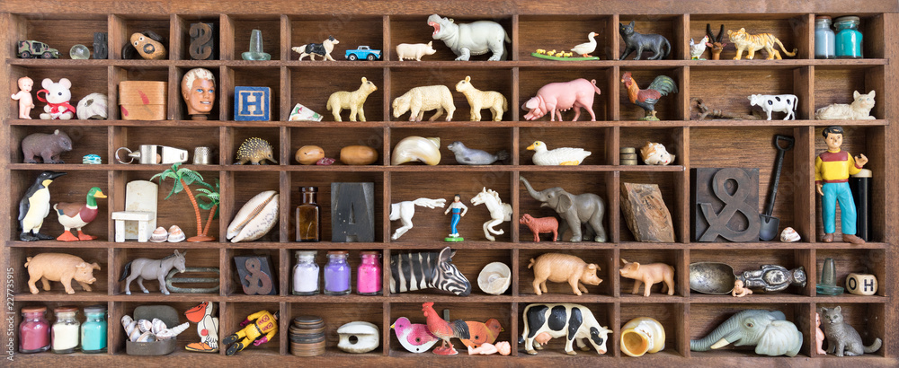 Fototapety, obrazy: Printers Oddments Tray Displaying Collection of Old Toys
