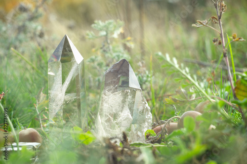 Large clear pure transparent great royal crystals of quartz chalcedony diamond brilliant on nature blurred bokeh autumn background close up