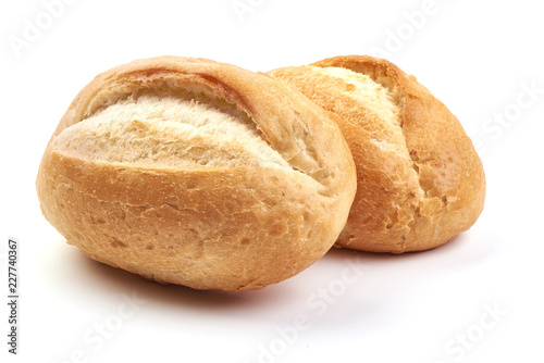 Freshly baked crispy bread rolls, close-up, isolated on a white background.