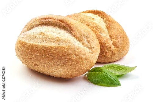 Spoed Foto op Canvas Brood Freshly baked crispy bread rolls with basil leaves, close-up, isolated on a white background.