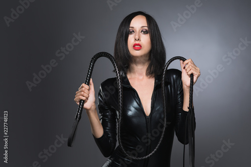 woman in latex suit on a dark background Slika na platnu