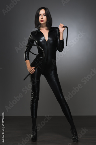 woman in latex suit on a dark background Fototapet